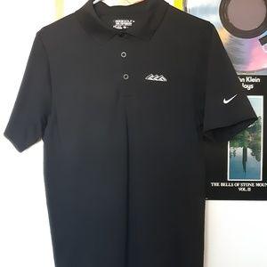 Black Nike golf polo.